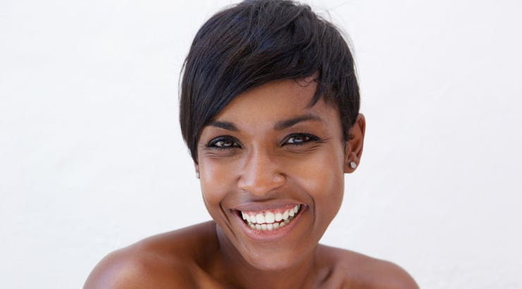 Smiling woman with low cut hair