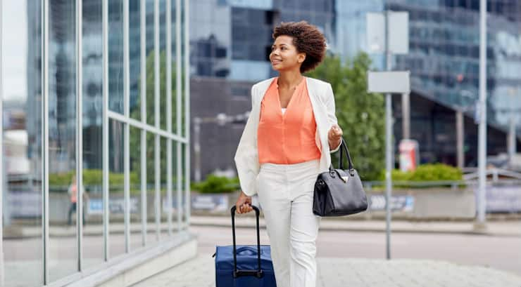 Black woman carrying luggage