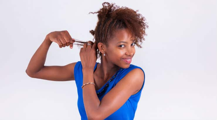 Black woman styling her hair