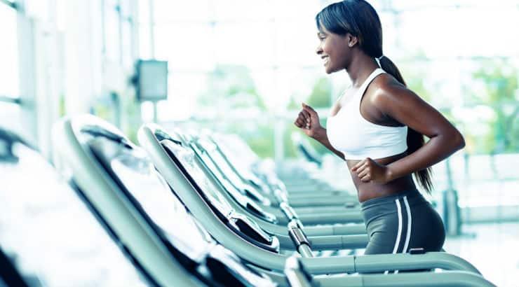 Woman Watching TV On Treadmill