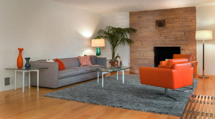 A living room with a warm rug