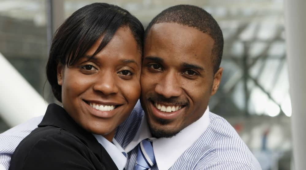 An African American couple hugging lovingly