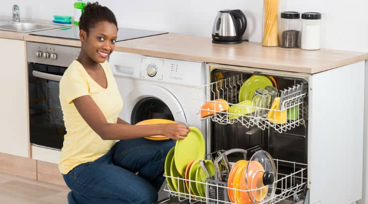 Black lady doing the dishes