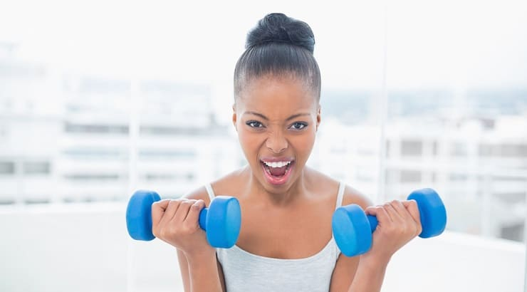 Black woman lifting weights