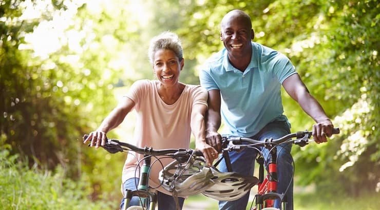African American duo happily riding their bikes