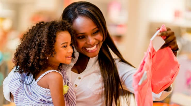 African American woman shopping with daughter