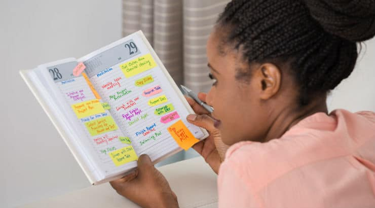 Black woman making a schedule