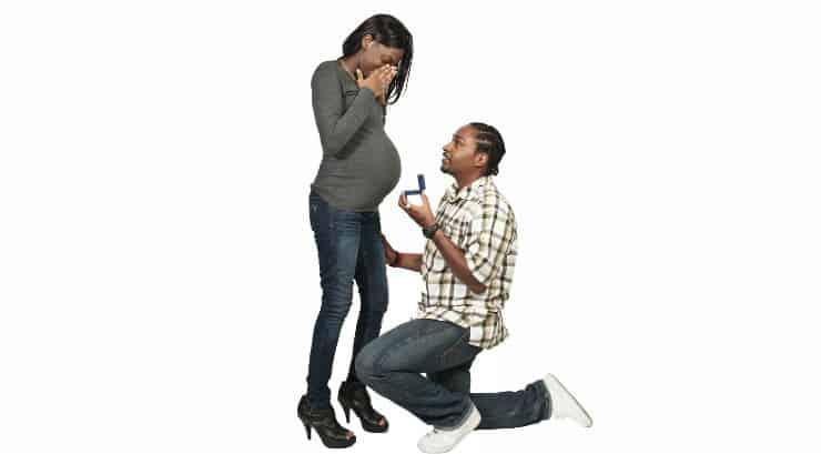 A black man proposing to his pregnant girlfriend
