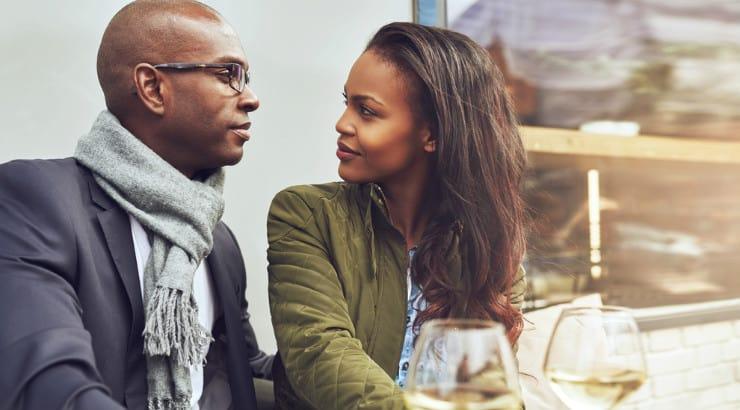 A black man and woman talking