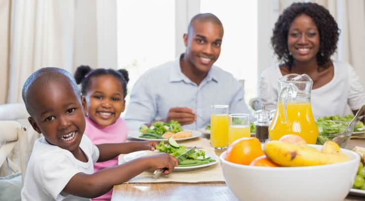 An African American family having dinner together