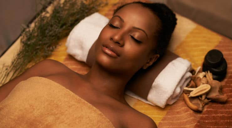 A black woman relaxing at a spa with a better family life