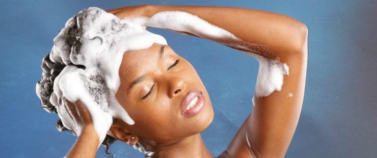 A black woman washing her hair