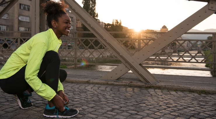 A black woman trying to live a healthier lifestyle by jogging