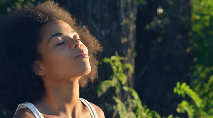 A black woman meditating