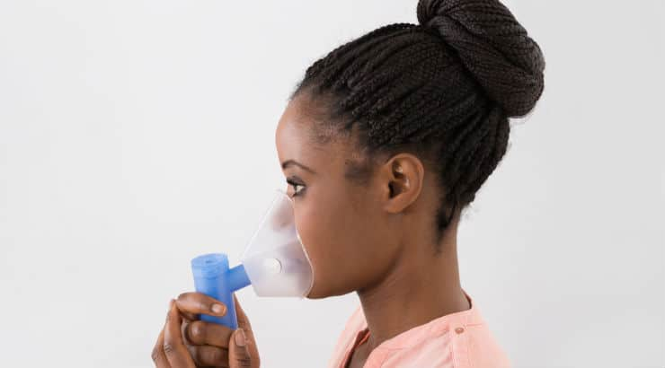 African American Young Woman Suffering From Asthma