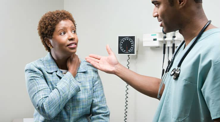 Black woman with her doctor