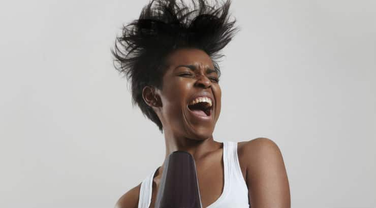 Black Woman With Blow Dryer