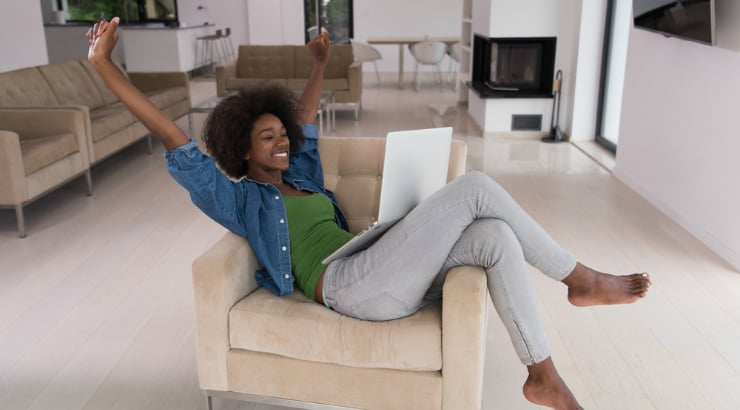 A woman of color chilling out at one of the best Airbnbs rooms around