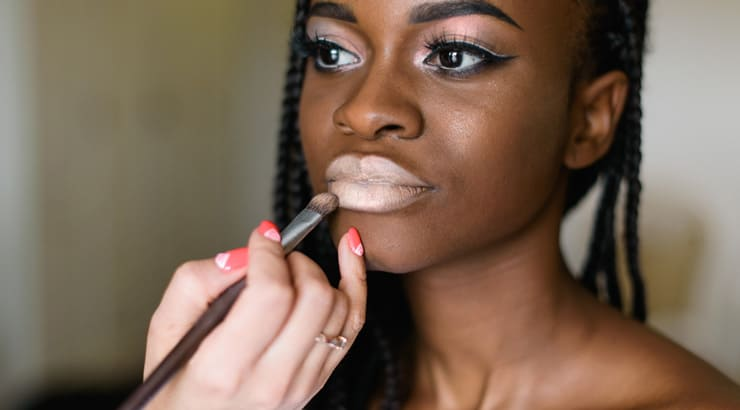An image of makeup applied to a black model