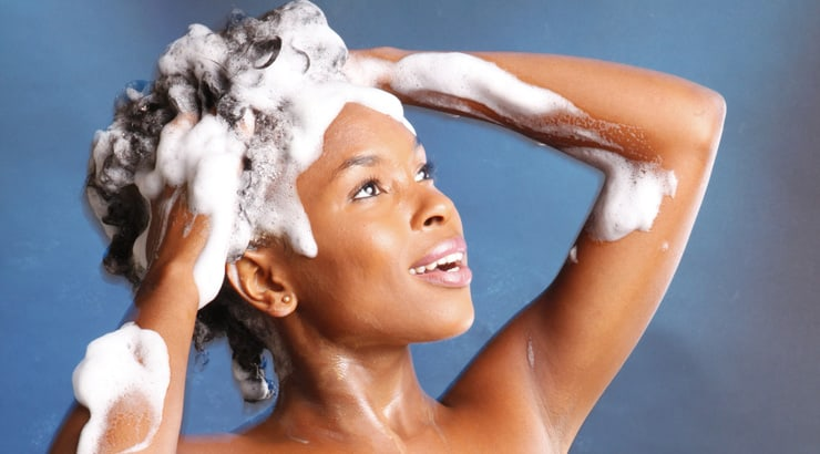 Black woman shampooing hair after a hot oil treatment