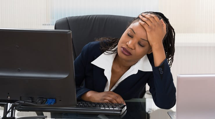Woman Showing Distress In Her Office