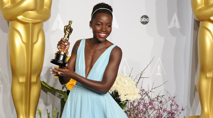 Lupita Nyong'o Holding Oscar on the Red Carpet