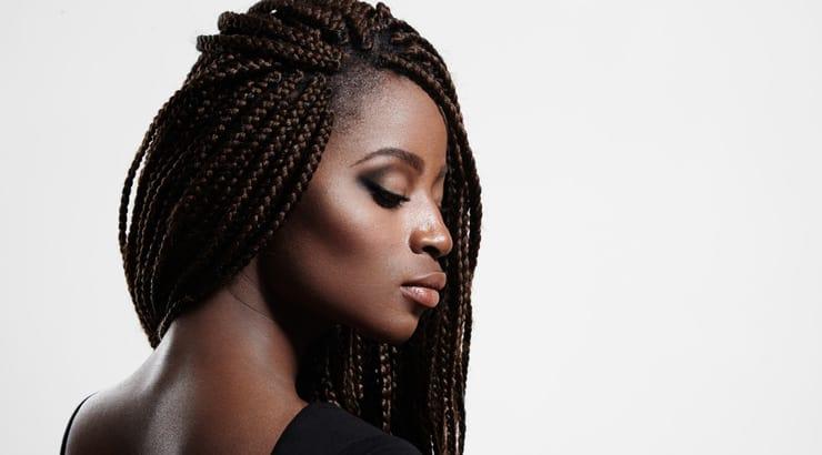 Dark Skinned Black Woman Wearing Braids and Light Makeup