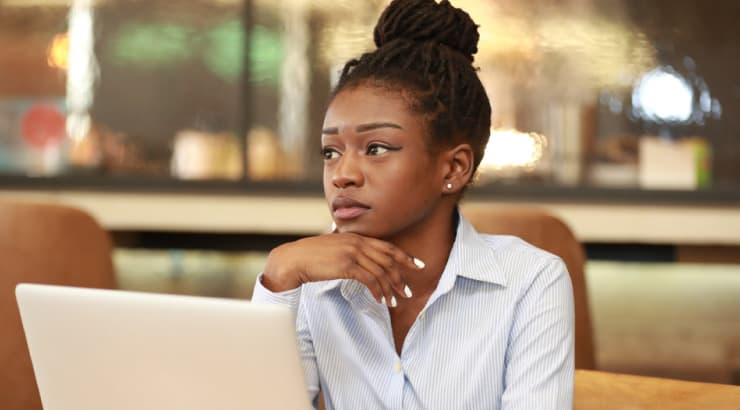 Black Girl Doing Research to Make Better Decisions on Her Vegan Diet