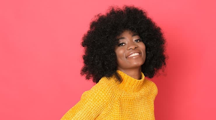 A spray bottle and wide-tooth comb are two important tools when detangling natural hair.