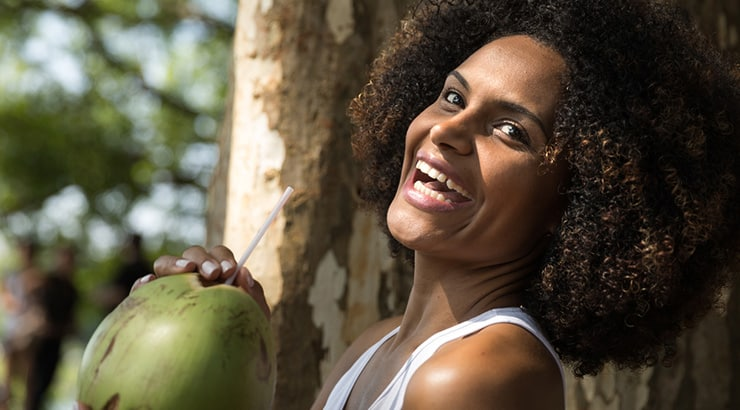 Black Woman Drinking Coconut Water