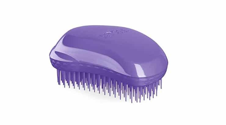 The Tangle Teezer Curly Styler is another compact detangler that provides grip comfort.