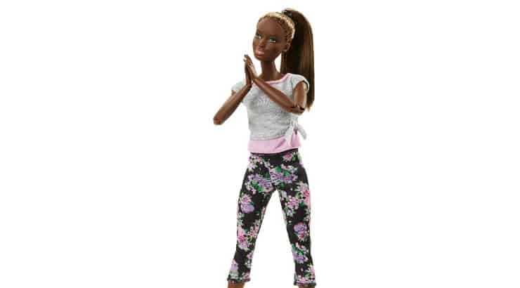 Barbie's Made to Move Doll comes with brown skin, green eyes, and long brown hair.