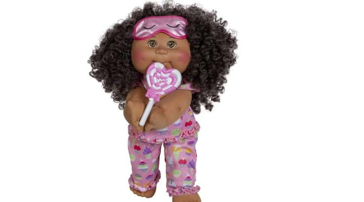 Cabbage Patch Kids is a popular brand with a black dolls with long, curly hair.