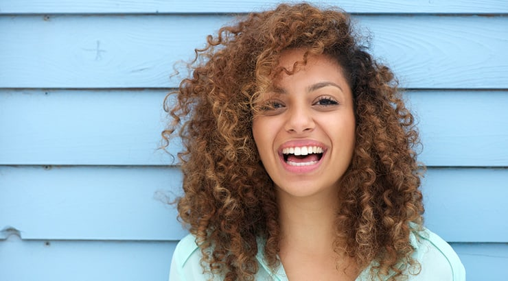 Mixed Race Girl With Curly Hair In Aqua Top