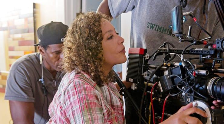 African American woman director Neema on camera