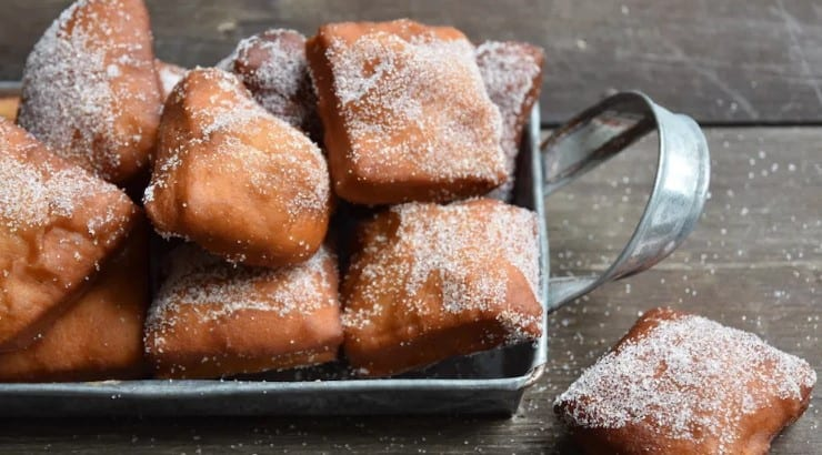 Mozambican mandazi often contains coconut milk and extra sugar for a sweeter taste.