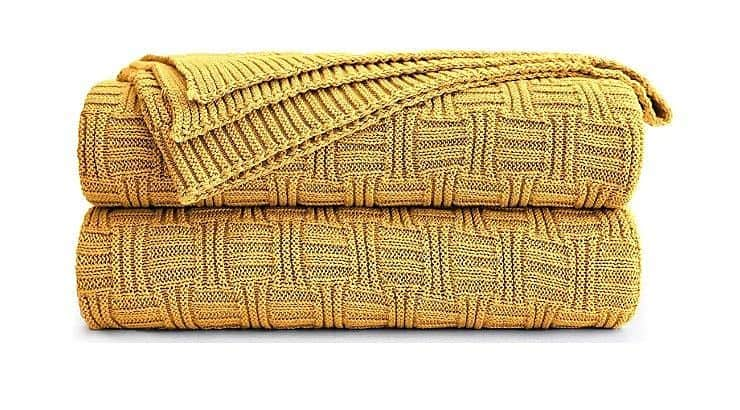 The Longhui Cotton Yellow Cable Knit Throw Blanket is a cozy and comfortable gift that also doubles as home decor.