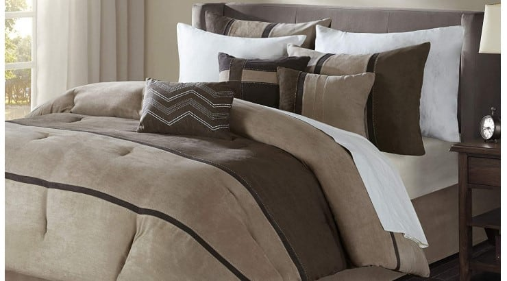 The Madison Parks Comforter Set is a full set that has a comforter, sham, and decorative pillows.