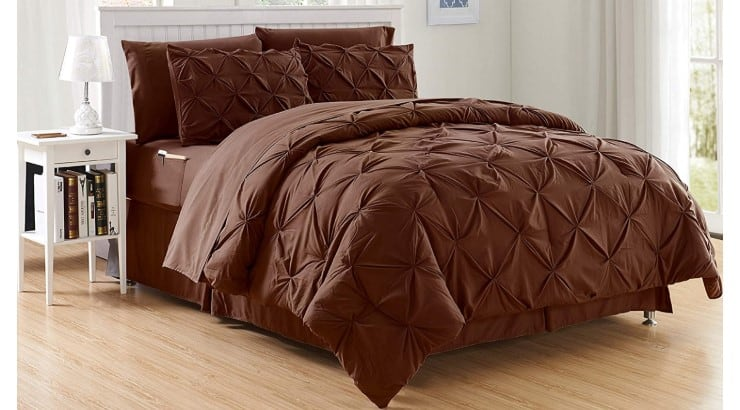 The Elegant Comfort 8-Piece Bed in a Bag is a luxurious set that includes a fitted sheet with double sided storage pockets for keeping items close.