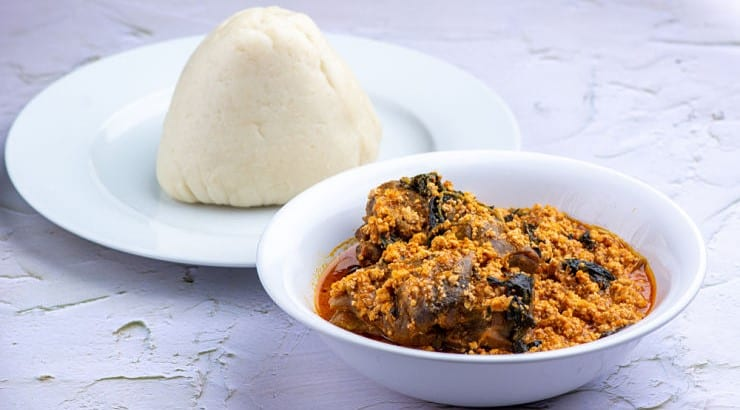 Egusi soup is often served with pounded yam, but can also be eaten with fufu or plantains.