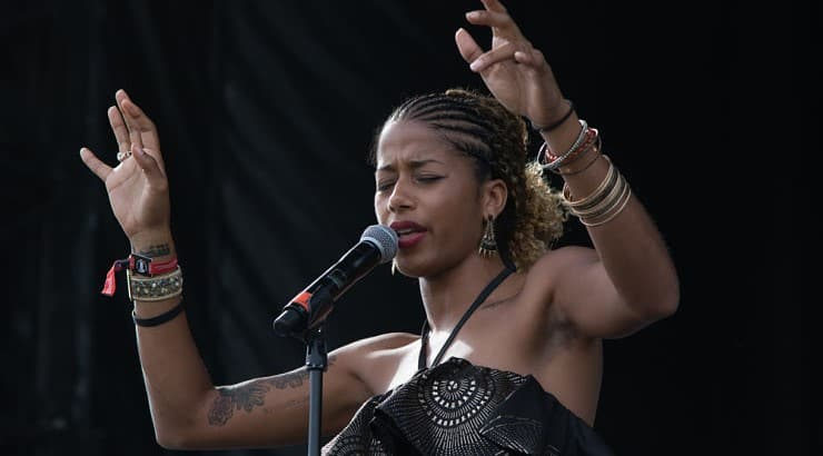 """Aja Monet is a poet of Cuban-Jamaican descent with her recent anthology, """"New Daughters of Africa,"""" released in 2019."""