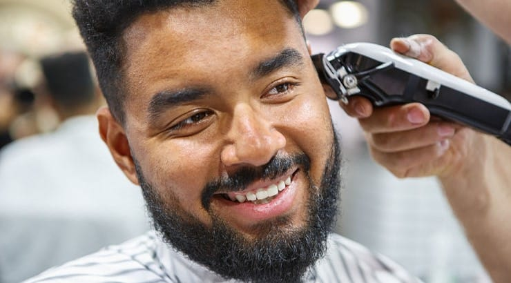 Regular haircuts can prevent people from experiencing breakage caused by split ends.