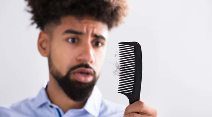 When growing an afro, get rid of heat styling tools that might damage the hair.