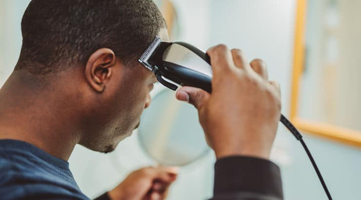 Getting a haircut before starting the journey to an afro will keep your hair growing at the same length.