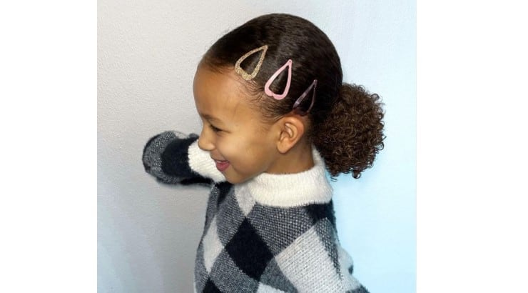 A low afro puff is a quick and easy hairstyle for little Black girls.