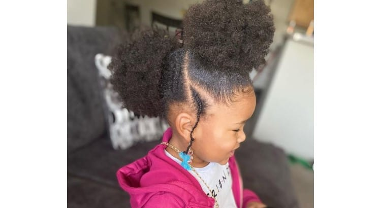 Afro puffs are popular, and their placement can be changed to create a new hairstyle.