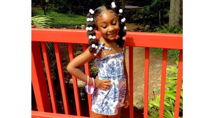 Hairstyles with bobbles are a popular and fun style for little Black girls.