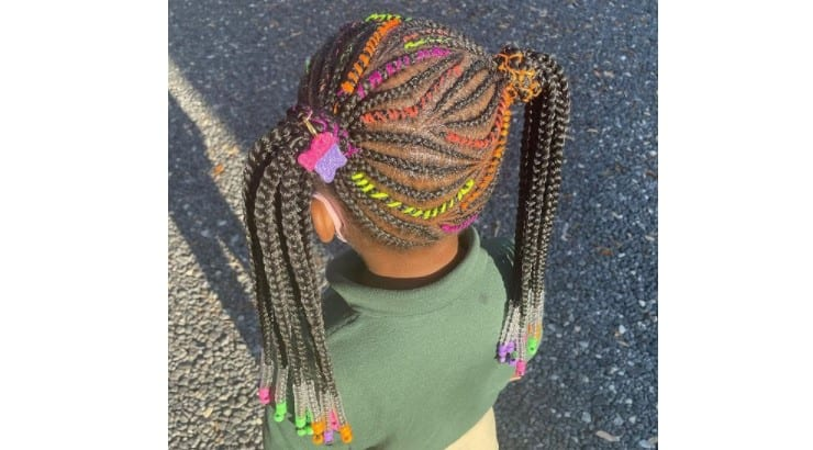 Adding clips and barrettes to braids are a common way of styling Black hair that has been used for decades.