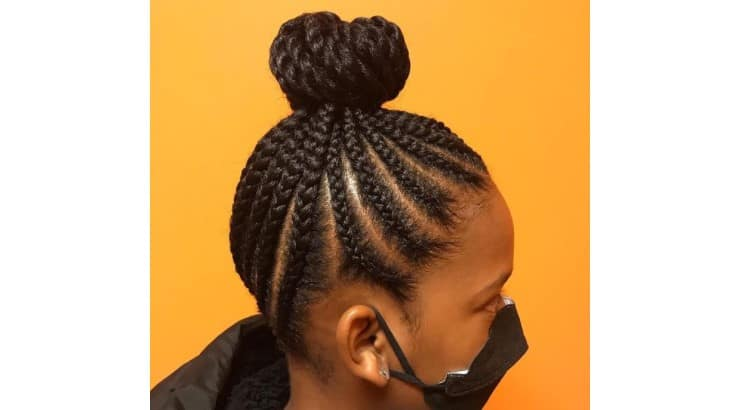 Using braids and twists in the same hairstyle is a growing trend.
